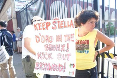 COMMUNITY ACTION: Union activist Judy Gonzales protests outside the Bronx-based Stella D'oro Biscuit Co. as the factory's striking employees returned to work July 7 after winning an 11-month strike. The workers are now organizing to stop the owners from closing the plant. PHOTO: MICAH LANDAU