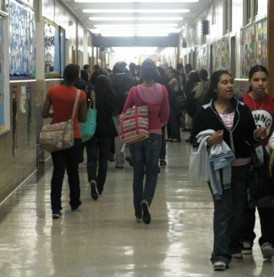 HEAVY LOAD: Students at Christopher Columbus High School in the Northeast Bronx hurry between classes. The school does not provide lockers, so the students must carry their books and coats with them all day. PHOTO: ASHLEY MARINACCIO