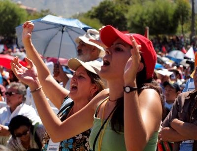 As United Nations representative Alicia Barcena addresses the crowd, her speech is drowned out by chants of `fuera` (leave) as conference goers express their discontent at what is seen in Boliva as an organisation only capable of representing the developed world. Photo by Reuben McCreanor