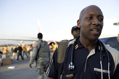 HAITI BOUND: Chief Colin Raeburn meets the second Bedford-Stuyvesant Volunteer Ambulance Corp contingent at the Toussaint Louverture International Airport in Port-au-Prince Jan. 23. The 24 volunteer-member team help unload medical supplies, food and water. The team arrived eager to get to work, but had been forced to leave half of their supply stock in New York City due to weight restrictions for travel. PHOTO: MICHAEL KIRBY SMITH