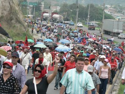 COUNTERING THE COUP: Thousands of people took to the streets of Tegucigalpa, Honduras, on April 20 to launch a campaign for a new constitution. PHOTO: GIORGIO TRUCCHI/Rel-UITA