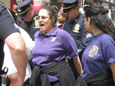 JAILED FOR JUSTICE: NYPD officers prepare to handcuff Lenore Freilander, Service Employees International Union 32BJ vice president, during a May 24 protest for immigration reform in Manhattan. PHOTO: RENÉE FELTZ