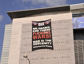 Banner dropped by Veterans for Peace in front of the Newseum in Washington, D.C. PHOTO: ELLEN DAVIDSON