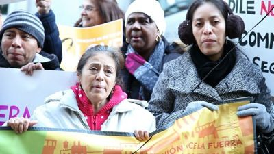 Immigrants and their supporters rallied outside Gov. David Patterson's midtown office and called for him to rescind Secure Communities in New York before he leaves office on Dec. 31. Photo: Renée Feltz