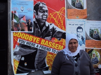 REFUSING TO BE SILENT: Soubhiya Abu Rahmah stands outside her home next to posters commemorating the deaths of her son and daughter. Bassem and Jawaher Abu Rahmah were both killed by the Israeli military while demonstrating against the separation barrier that illegally confiscates land in their village. PHOTO: Alex Kane