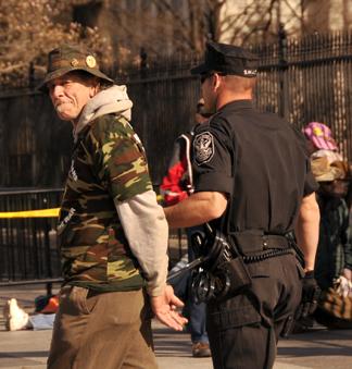 Watermelon Slim is taken into custody Marhc 19 at the White House. Photo by ELLEN DAVIDSON