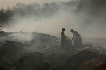 People collect scraps from a garbage dump in Hyderabad, India. PHOTO: AP / Mahesh Kumar A.