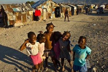 joy to the world: Children in the Cite Soleil slum, a bastion of support for former President Jean-Bertrand Aristide. PHOTO: Isabeau Doucet