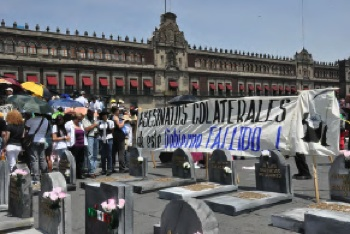 "Mounting Toll: At the national ""March for Peace"" that culminated in a rally of over 100,000 people in Mexico City on May 8, a mock cemetery is erected representing the victims of the government's failed drug war. PHOTO: Kara Newhouse"