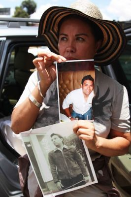 Julia holding a photo of her son.