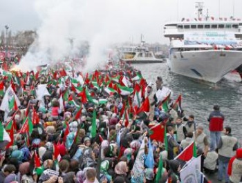Supporters cheer as the Mavi Marmara returns from the first Gaza Freedom Flotilla. CREDIT: SocialistWorker.org