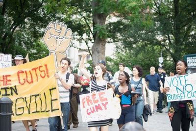HELLO, NEIGHBOR: Bloombergville participants march around the perimeter of City Hall Park. Established near City Hall on June 14, Bloombergville served as an around-the-clock protest encampment to mobilize opposition to the mayor's proposed budget cuts. (Credit: Joseph Kolker)