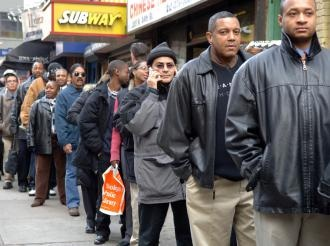Applicants line up at a job fair at the New Yorker Hotel in January 2007. PHOTO: Frances Roberts/SocialistWorker.org