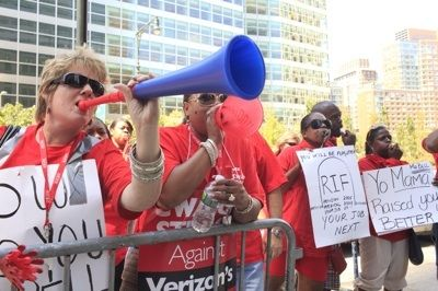 PICKET POLITICS: During the two week Verizon strike, Communication Workers of America members held daily protests outside Verizon's headquarters in downtown Manhattan, refusing the more than 100 different concessions demanded by the company. (Credit: Dave Sanders)