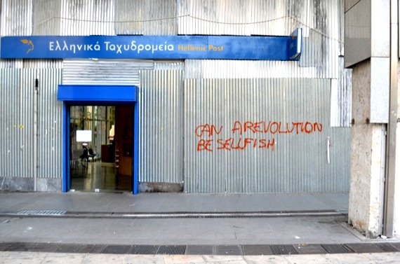 A post office facing Syntagma Square. Pieces of marble from the column at right have been torn off for use as projectiles. (Photo: WagingNonViolence.org)