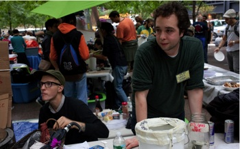 CREATING COMMUNITY: (Above, right) Chris O'Donnell, 24, of Bushwick, Brooklyn, takes a break at the Occupy Wall Street encampment. The kitchen has been serving free meals to as many as 1,000 people a day. (Photo by Amelia Holowaty Krales)