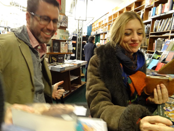 Customers at the recently rescued St. Mark's bookstore make their purchases. (Photo: Shell Sheddy)