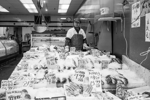 A man sells fish and other seafood.