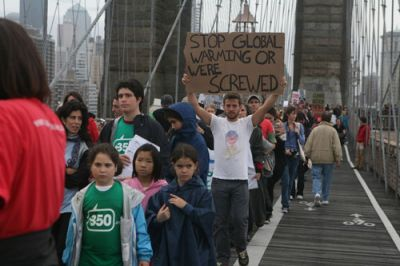 REALITY CHECK: Climate activists on the Brooklyn Bridge Oct. 24. FLICKR.COM/OOHMYGEEZ