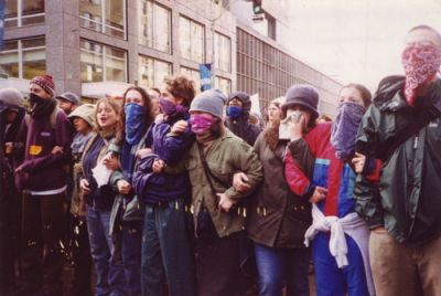 LOCKING ARMS: On Nov. 30, 1999, thousands of opponents of corporate-led globalization nonviolently took control of the streets in downtown Seattle. PHOTO: STEPHANIE GREENWOOD