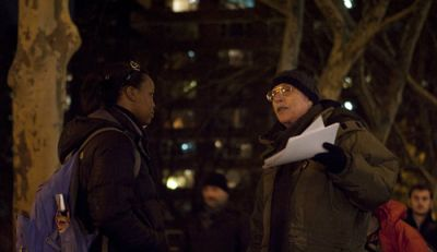 OUTSPOKEN: Chuck Zlatkin of Chelsea Neighbors United Against the War, talks to a passerby on the northwest corner of 24th Street and Eighth Avenue Dec. 8 at the group's weekly antiwar vigil. PHOTO: ANDREW HINDERAKER
