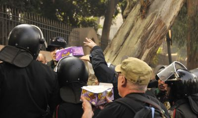 Passing coffee in to the French protesters