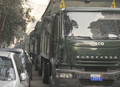 Police trucks lined the street opposite the French Embassy in Cairo December 28.