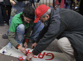Painting a banner at the French Embassy