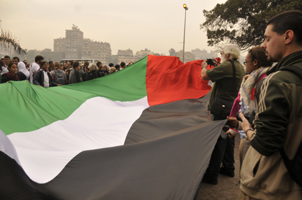 Protesters billowed a giant Palestinian flag