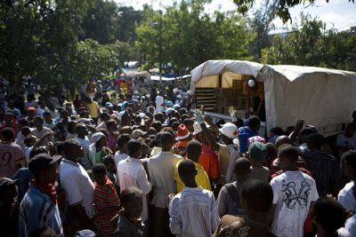 Haitians wait for aid from the Red Cross to be unloaded. PHOTO: American Red Cross/Talia Frenkel
