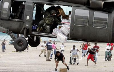 A military helicopter drops food and water to survivors of Hurricane Katrina near the Convention Center. PHOTO CREDIT: Bruce Downs