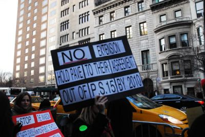 TAKING IT TO THE MAN: Opponents of Mayor Bloomberg's school closings plan march Jan. 21 outside his mansion (back right) at 17 East 79th Street in Manhattan. PHOTO: SOPHIE FORBES