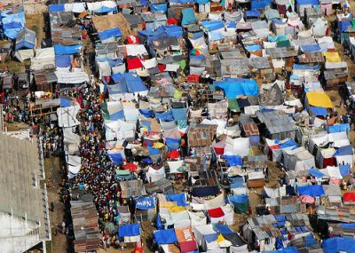 Haitians gather on the streets of one of the many tent cities occupying the area of Leogane. PHOTO CREDIT: FLICKR.COM/MARINE CORPS NEWS
