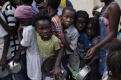Children wait in line for food in downtown Port-au-Prince, Feb. 2. PHOTO CREDIT: MARK OVASKA