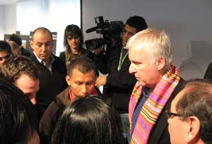 """James Cameron talks to members of the audience after the """"Real Life 'Pandoras' on Earth: Indigenous Peoples Urgent Struggles For Survival"""" panel."""