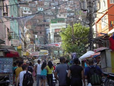 LIVELY STREETS: Residents and vendors crowd the streets of favela Riconha in Rio de Janeiro. About 400,000 people live in the community, which borders Ipanema Beach. PHOTO: ROB ROBINSON