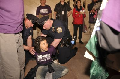 War Resisters League's Liz Roberts being taken into custody at Grand Central Station May 3. Photo by Ellen Davidson