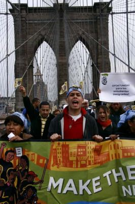 WALK THE WALK: Members of Make the Road New York, a social justice organization, marched across the Brooklyn Bridge as part of their May Day actions.