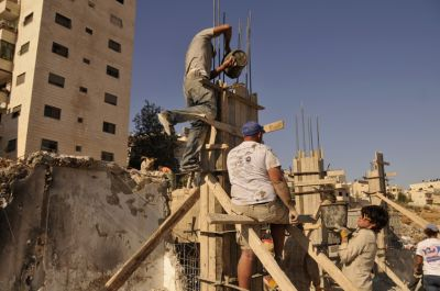 Pouring the concrete into the forms for the pillars to hold up the roof. PHOTO: ELLEN DAVIDSON