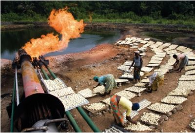 In the oil town of Afiesere, local Urhobo people bake krokpo-garri, or tapioca, in the heat of a gas flare. Pollutants from the flares cause serious health problems, shortening the life expectancy of the Urhobo.