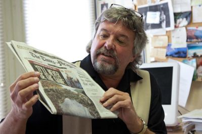 Dr. Anthony Ladd, showing a cover story about trauma caused by the BP oil disaster. (Photo: Erika Blumenfeld © 2010)