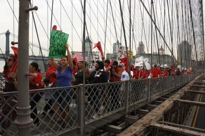 CROSSING BRIDGES: Immigrants and allies from a variety of groups — including VAMOS Unidos, Wind of the Spirit and the Northern Manhattan Coalition for Immigrant Rights — marched in solidarity with immigrant communities in Arizona. Many groups spoke out against the possibility of copycat legislation. PHOTO: SAKURA KELLEY