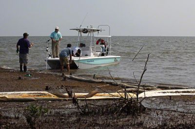 Sampling team on oil-soaked beach, Casse-Tete Isle, Louisiana, August, 16, 2010. PHOTO: Erika Blumenfeld