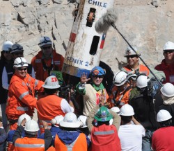 Chilean miner Carlos Barrios leaves the Fenix rescue capsule. Barrios was the 13th miner brought to the surface on Oct. 13.   (Photo by RODRIGO ARANGUA/AFP/Getty Images)
