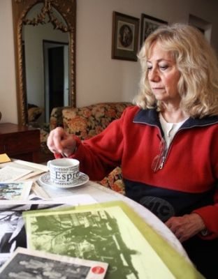 Evie Lou Hunt, of Leblon, Tennessee, looks at old pictures of her brother in her apartment in Mendoza, Argentina. PHOTO: JOSEPH HUFF-HANNON