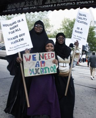EDUCATION IS A RIGHT: A mother and her two daughters participate in an Oct. 7 march through Harlem that was part of the National Day of Action to Defend Public Education. PHOTO: SAKURA KELLEY