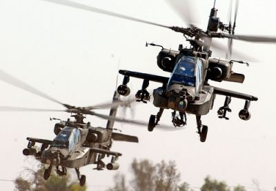 APACHES OVER BAGHDAD: With garrisons arount the planet and military spending greater than the rest of the world combined, the United States is saturated with the weapons, methods and culture of war. CREDIT: FLICKR