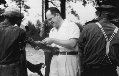 A researcher in Tuskegee, Alabama, with black men recruited for the Public Health Service's syphilis experiment. PHOTO: Records of the Centers for Disease Control and Preventio
