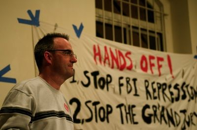 Hands off: Tom Burke, a subpoenaed antiwar activists, speaks to a packed room at St. Mark's Church for the first meeting of the Committee to Stop FBI Repression. PHOTO: JED BRANDT