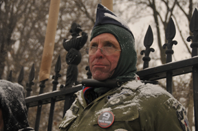 Veterans For Peace board member Elliott Adams chained himself to the White House fence with a bicycle lock Dec. 16. Photo: ELLEN DAVIDSON